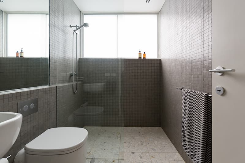 Modern walk in shower with mosaic full height tiles